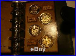 HARRY POTTER COIN COLLECTION SAVINGS BOOK. In 24k gold 24 coins in book, stunning
