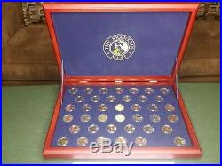 The Franklin Mint Presidential Gold Dollar Coin Collection in Wood Case